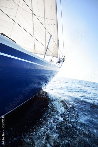 Blue yacht sails on a clear sunny day  Close-up  Baltic sea, Latvia