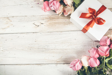 roses with gift box on desk