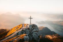 Mountain Summit Cross On Alpine Peak At Sunset
