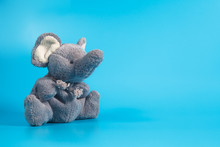 Funny Cute Grey Gray Plush Elephant Toy Isolated On Col Background. Isolated, Blue, Red, White. Copy Space For Text.