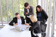 business people discussing company profit or project result in meeting room