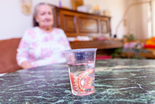 Dentures Of An Old Lady In A Glass Of Water