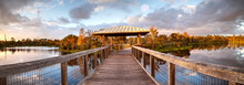 Moonrise At Sunset Over Gazebo On A Wooden Secluded, Tranquil Boardwalk