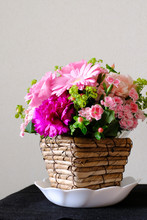 Bouquet Of Flowers In A Basket Isolated On White