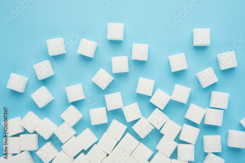 Fotografie, Obraz  White sugar cube isolated on blue background top view food drink cooking object