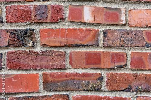 New brick wall, new texture of red stone blocks closeup