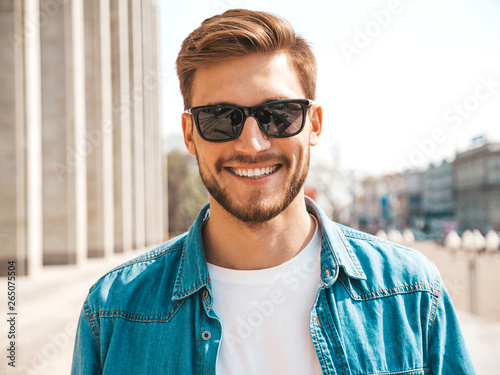 Fotografie, Obraz  Portrait of handsome smiling stylish hipster lumbersexual businessman model