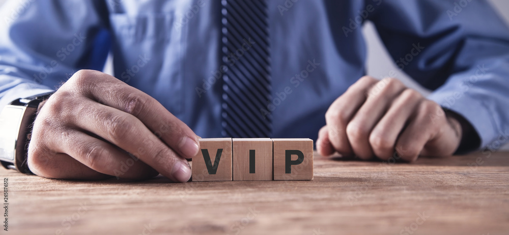 Fototapety, obrazy: Man showing Vip word on wooden block.