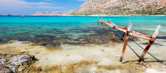 An old and rusty jetty at a bay on the island of Crete, Greece.