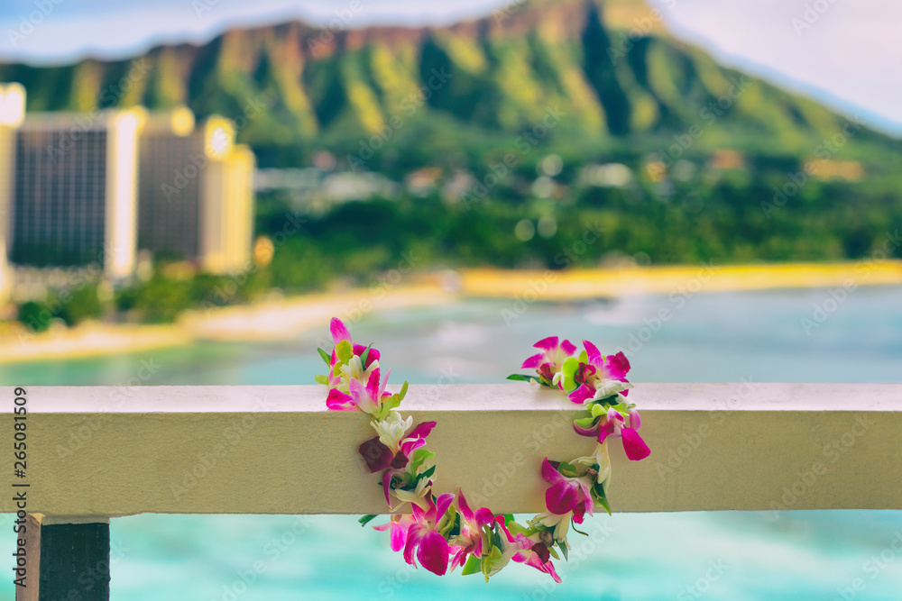 Fototapeta Hawaii background hawaiian flower lei with Waikiki beach landscape.