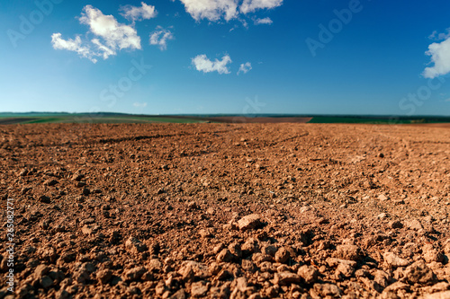 Fotobehang Cultuur Ploughed field in spring prepared for sowing