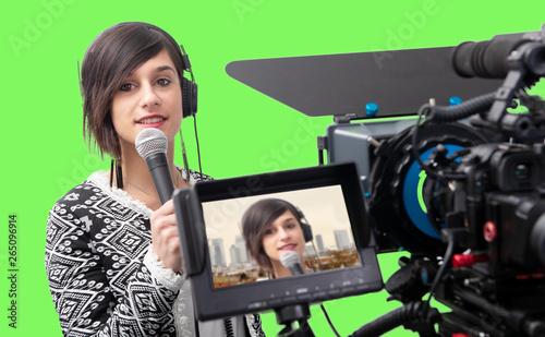 Obraz na plátne pretty young woman  journalist presenting report in television studio