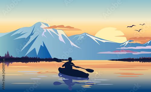 Fototapety, obrazy: Kayaking in the mountain lake at sunset