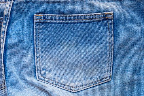 Fotografia Blue denim jeans back pocket close up
