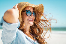 Mature Woman With Beach Hat An...