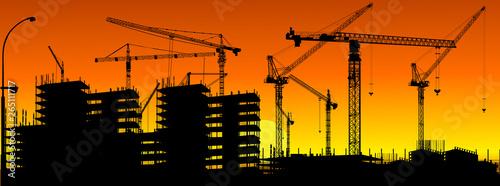 Obraz na płótnie orange and black strip with building cranes
