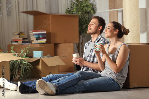 Happy couple moving home resting breathing fresh air