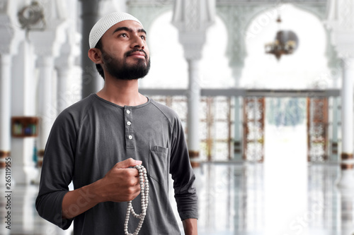 Religious muslim man praying in mosque Fototapeta