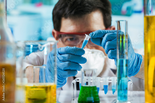 Researcher holding tube pcr in the laboratory /Chemist engineer holding test tub Wallpaper Mural