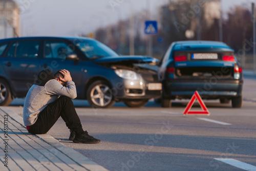 Sad man after car accident Wallpaper Mural