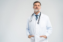 Cheerful Mature Doctor Posing And Smiling At Camera, Healthcare And Medicine.