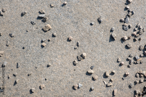 Small granite stones scattered on a granite slab - Buy this