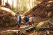 Leinwandbild Motiv Group of children building camp in forest
