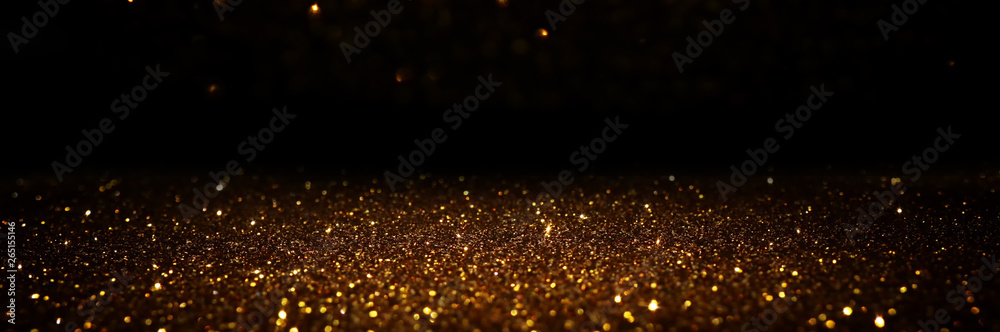 Fototapeta glitter vintage lights background. black and gold. de-focused