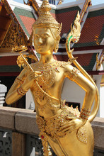Statue Of Divinity (?) In A Buddhist Temple (Wat Phra Kaeo) In Bangkok (thailand)