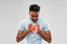 People, Healthcare And Health Problem Concept - Unhappy Man Having Heart Attack Or Heartache Over Grey Background