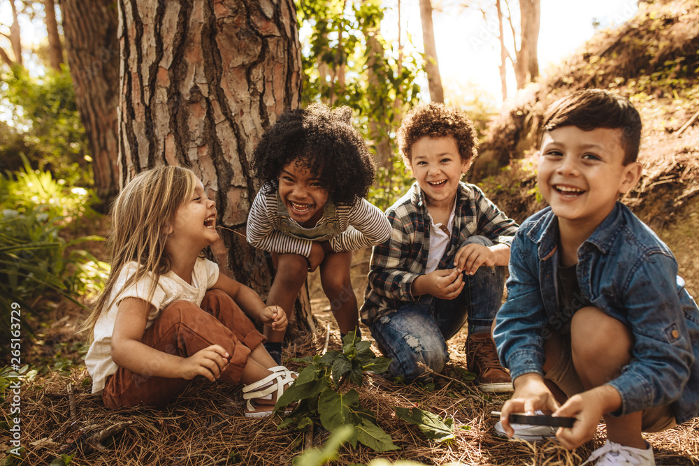 Fototapety, obrazy: Group of cute kids playing in forest