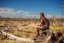 Woman In Dead Tree Forest