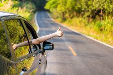 Woman In The Car Showing Her Thumb Up Sign.  Safe Driving Concept.  Transportation And Driving Concept And Background.