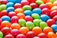 Rainbow Colors Of Multicolored Candies Close-up, Texture And Repetition Of Dragee