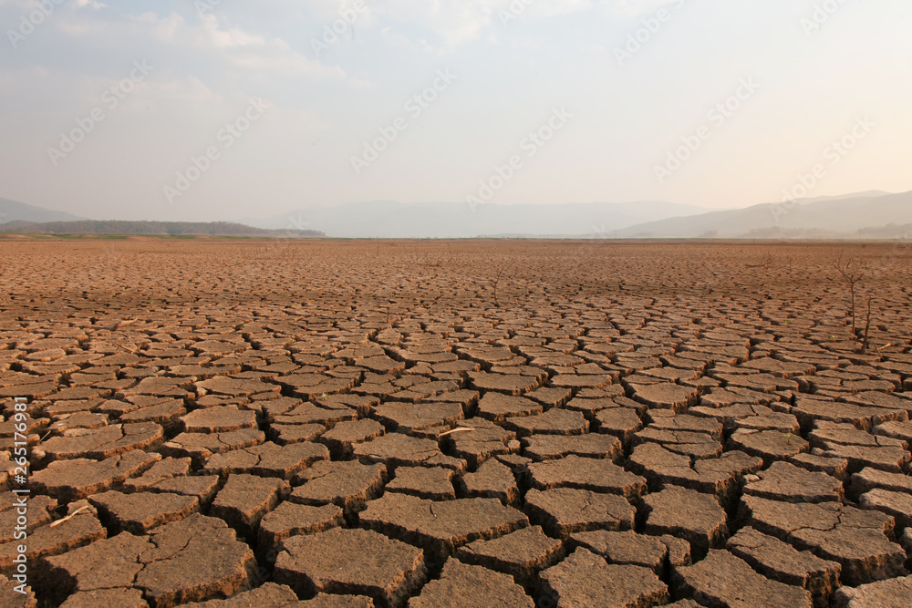 Fototapeta Dry river and lake after drought impact on summer, Landscape of Cracked earth metaphor climate change and drought