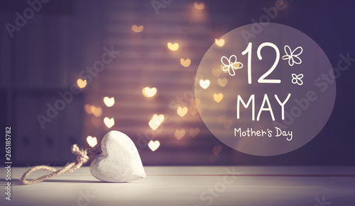 Fotografie, Obraz Mother's Day message with a white heart with heart shaped lights