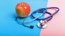 Stethoscope And Apple Between ...