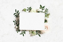 Feminine Wedding, Birthday Mock-up. Blank Paper Greeting Card. Floral Frame Of White, Pink Ranunculus, Carnation And Astrantia Flowers, Lentisk Leaves. Concrete Table Background. Flat Lay, Top View.