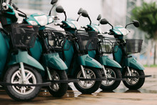 Blue Moped Scooters For Sale Or Rent Parked In A Row At Parking