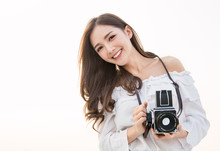 Portrait Of Beautiful Asian Woman Photographer Fashion Look Taking Photo. Pretty Cool Young Woman Model With Retro Film Camera Curly Hair Outdoors With Copy Space