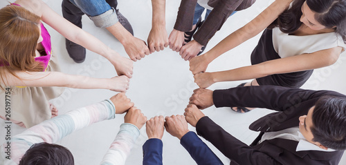 Fotografie, Obraz  Multicultural hands synergy brainstorm business man woman in circle top view