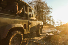 Old Vehicle With People On An Off Roading Adventure