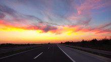 DRONE: Picturesque Shot Of A Sunset Shining On The Highway Crossing The Country.