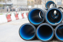 Overhaul Of PVC Water Pipes In The City, Front View, Blurred Background. Water Supply Concept. Repair Of Utilities