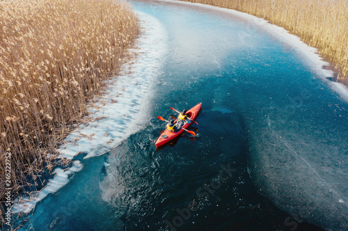 Obraz two athletic man floats on a red boat in river - fototapety do salonu