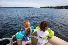 Two Toddler Aged Girls Fishing...
