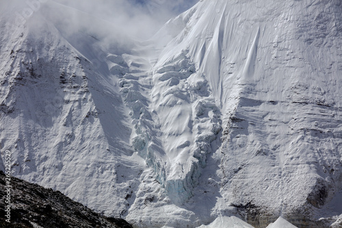 Obraz na plátně  Snow Mountain, Massive Glacier, Wall of Ice, Mountain Cliff Face covered in ice,
