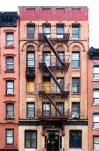Old Condemned Building With Boarded Windows In The Lower East Side Neighborhood Of Manhattan In New York City