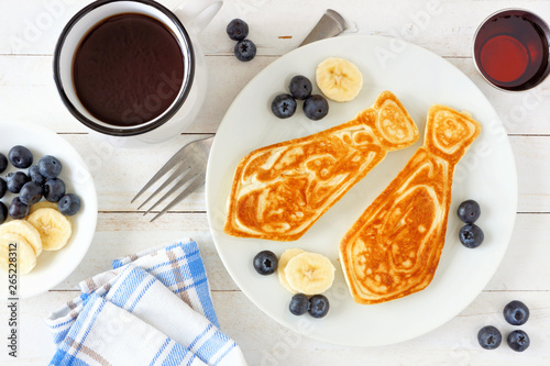 Fotografie, Obraz Tie shaped pancakes with blueberries and bananas