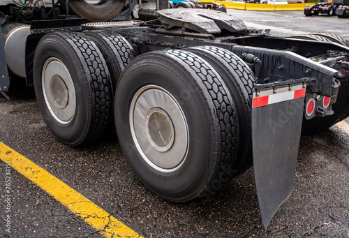 Photo Wheelbase of big rig semi truck with two axles and pairs of wheels on them and f